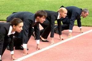 Confident business people lined up getting ready for race